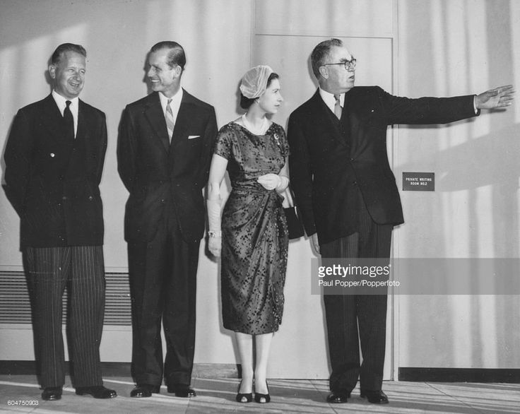 Queen Elizabeth II and Prince Philip, Duke of Edinburgh (second left) are given a tour of the United Nations General Assembly by UN Secretary General Dag Hammarskjold (left) and UN General Assembly President Sir Leslie Knox Munro (right), during a visit to New York City in the United States on October 21st 1957.