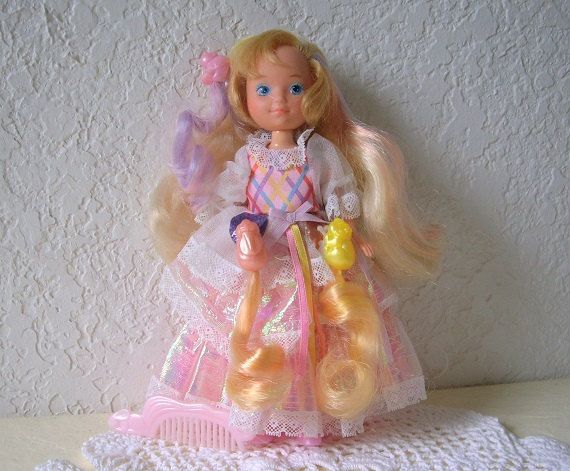 Lady Lovely Locks doll wearing her original dress with three