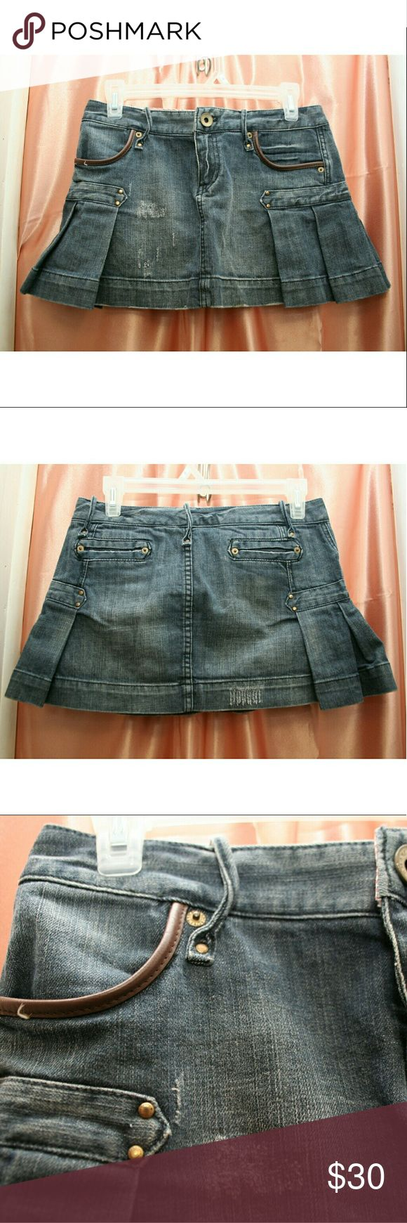 Mini denim skirt Very cute and comfy pleated denim skirt. It is in excellent condition . The quality is exceptional, it has a distressed look to it. I cant use it anymore i gained weight it's too short for me now. A little stretchy. It doesnt go up or down like many mini skirts i had before. Armani Exchange Skirts Mini
