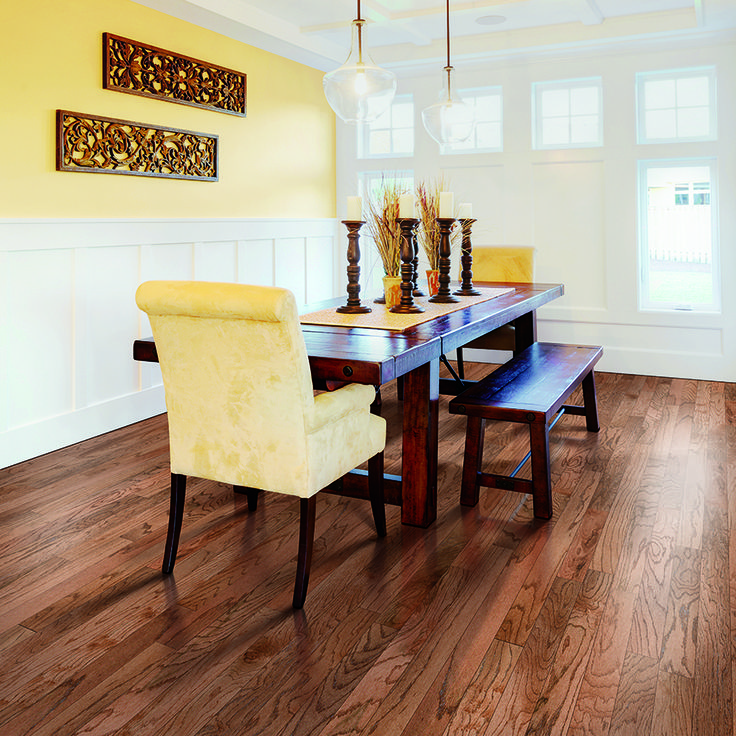 Yellow Walls A Bench Style Dining Room Table And PERGO Max Gunstock Oak Hardwood Floor