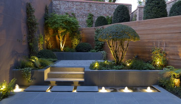 pond fountain effect with lighting opportunity. Paving colour palette to compliment house materials.