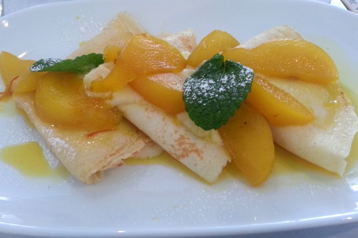 Breakfast Menu :  Light crepes with pear poached in lemon and saffron syrup and a dollop of chantilly cream or mascarpone
