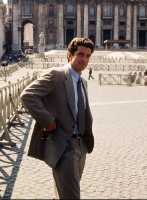 John F. Kennedy Jr. poses in front of St. Peter's at the Vatican Saturday April 20, 1996. Kennedy Jr. is in Italy to interview famed fashion designers such as Valentino, Versace and others. (AP Photo/Maurizio Marucci)