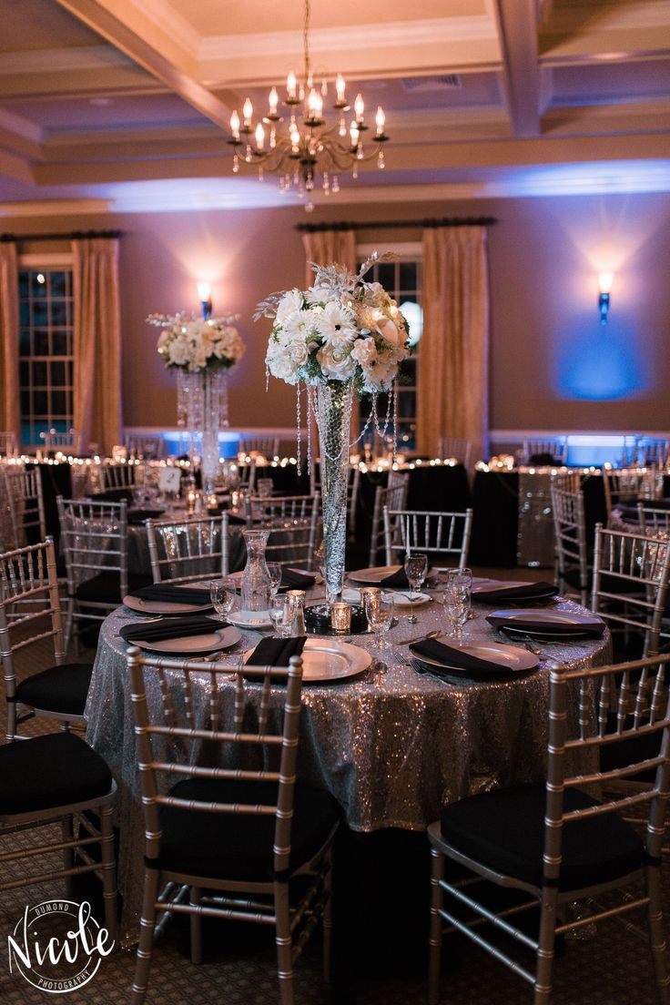 Black Floor Length Table Cloths with a Silver Sequin Overlay, Silver Charger Plate & Pleated Black Napkin