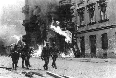 One way Nazis suppressed the Warsaw Ghetto Uprising was to burn blocks of buildings.