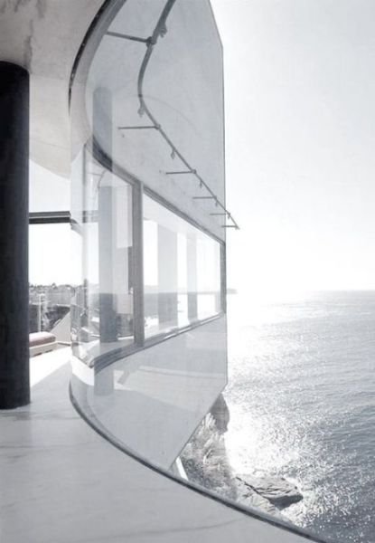 A complex series of fluid living spaces set within a meandering perimeter that arcs, folds and stretches in response to sun, landscape and views. Ocean view