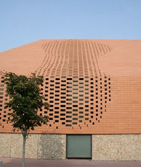 Pixelated brick skin exterior, Pope John Paul II Hall in Rijeka, Croatia, by Randić-Turato Architects.