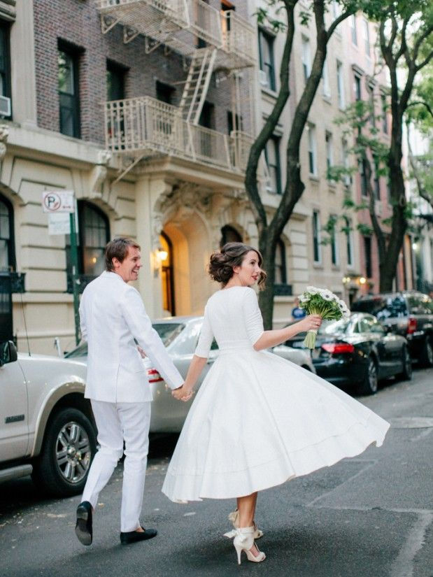 Beautiful tea length wedding dress in New York via http://www.greylikesweddings.com/real-weddings/destination-to-new-york-a-city-loft-wedding/