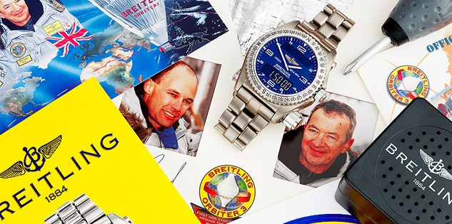 A Breitling Emergency watch worn on the first ever round-the-world hot air balloon flight has sold at auction, with all proceeds going to charity.