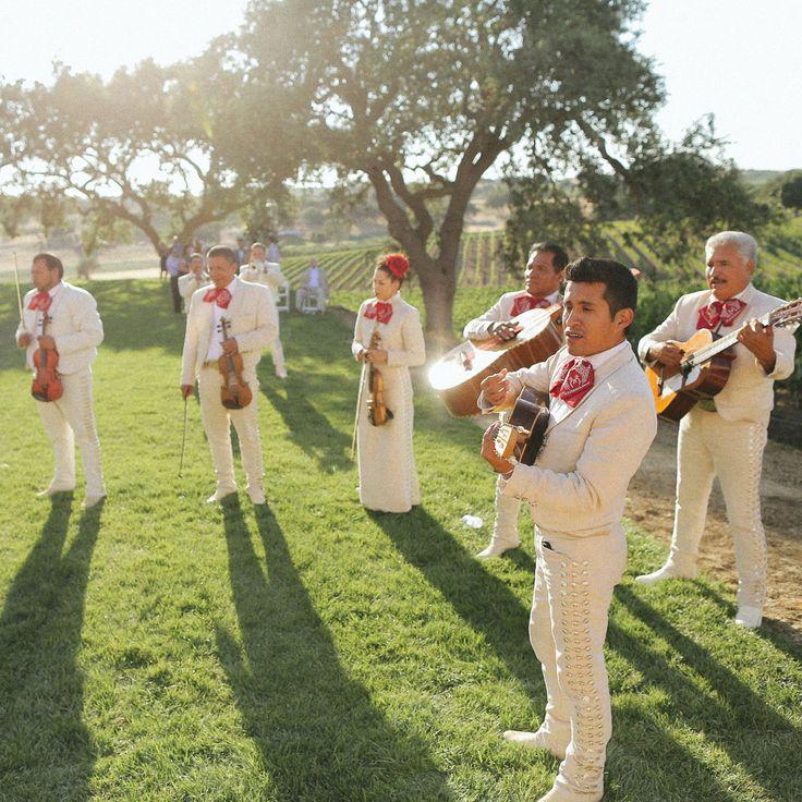 A mariachi band to greet guests | Dennis Kwan Weddings | Brides.com