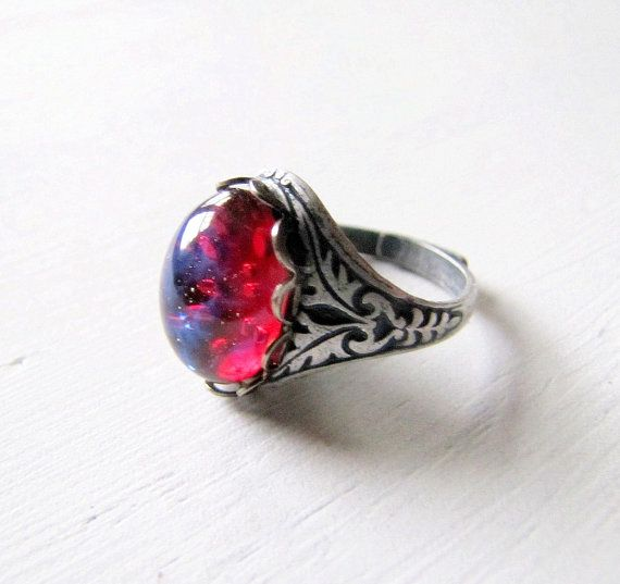 Fire Opal Dragons Breath Ring by TwigsAndLace.  It looks like space inside this stone... <3