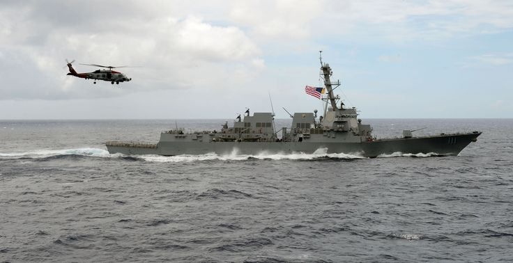 """SOUTH CHINA SEA (June 28, 2016) An MH-60R Seahawk, attached to the """"Warbirds"""" of Helicopter Maritime Strike Squadron (HSM) 49, flies over the guided-missile destroyer USS Spruance (DDG 111). The guided-missile destroyers Spruance, USS Momsen (DDG 92) and USS Decatur (DDG 73) are deployed in support of maritime security and stability in the Indo-Asia Pacific as part of a U.S. 3rd Fleet Pacific Surface Action Group (PAC SAG) under Commander, Destroyer Squadron (CDS) 31. (U.S. Navy photo by…"""