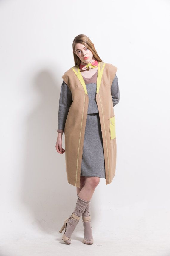 Raw edge appliqué long vest by couturierholiday on Etsy, $295.00