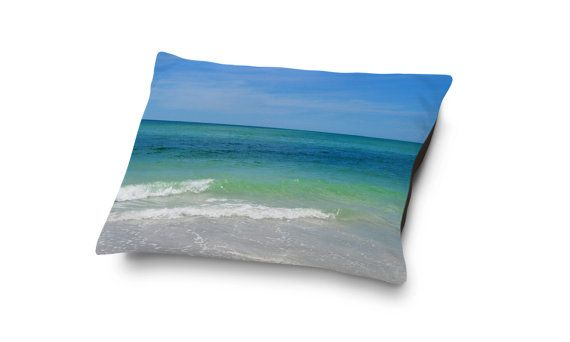 For your beach loving animal companion, this coral fleece pet bed features a vibrant blue green sea ocean style print face side! Available in three