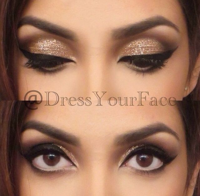 Gold and brown eye makeup with very bold black eyeliner. Look at how huge her eyes look! Perfect!