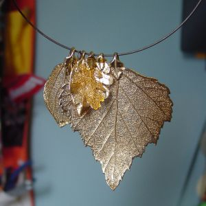 Electroplated leaf pendants. eHow.com has a short tutorial on how to create your own metal leaves! Clcik photo for more.Photo courtesy of graciousgood.wordpress.com.