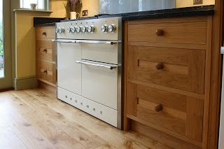 The Mercury range cooker featured here in Oyster is incorporated effortlessly into this shaker style kitchen by featuring a mix of oak and painted cabinets