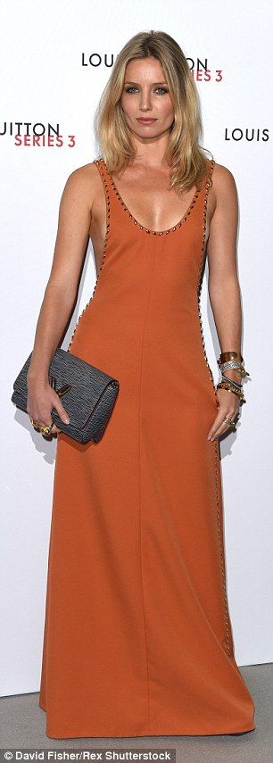 Annabelle makes a statement in a plunging, burnt orange-coloured dress at the Louis Vuitton Series 3 launch party in London in September
