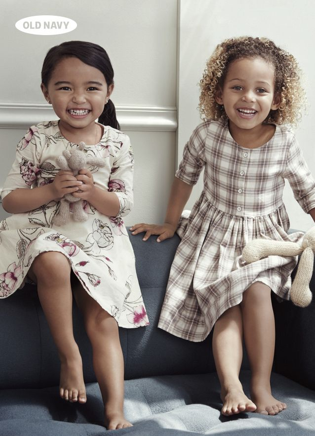 How cute are these sweet-cheeked girls! Perfectly coordinated in floral & gingham dresses, too… they must have exchanged style notes.