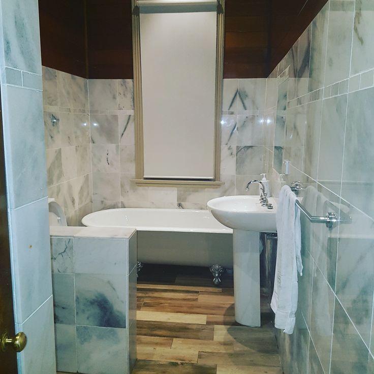 Classic bathroom renovation. Marble walls, timber look porcelain floor.