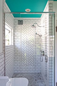 I adore the section of herringbone tile in the shower. It is eye catching yet still classy cool. I HATE the black grout though!