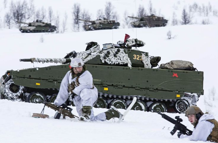 The Norwegian Brigade North advances during a live-fire exercise in the Setermoen Shooting Range