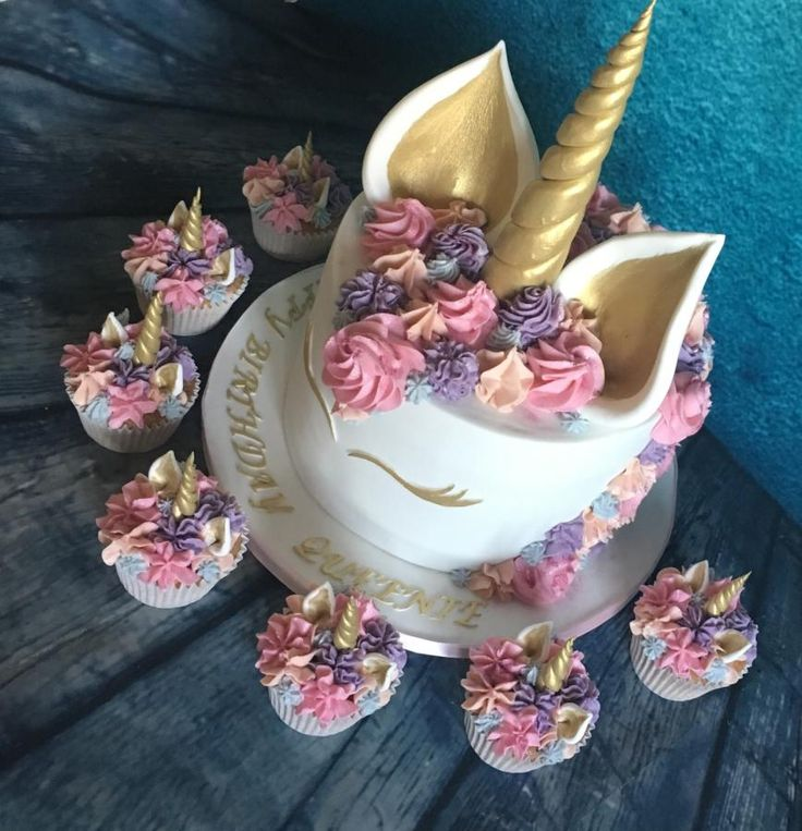 Pastel pink unicorn cake and cupcakes by Meme's Cakes