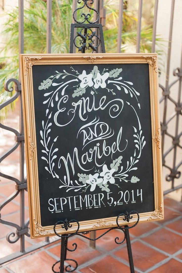 This gilt-framed welcome sign was crafted by using chalk ink markers.