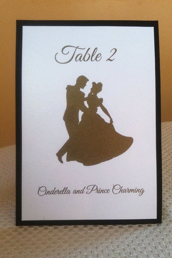 Disney Silhouette Table number Signs on Etsy, $4.50. Not sure if it would go with my enchanted forest theme, but I want it!