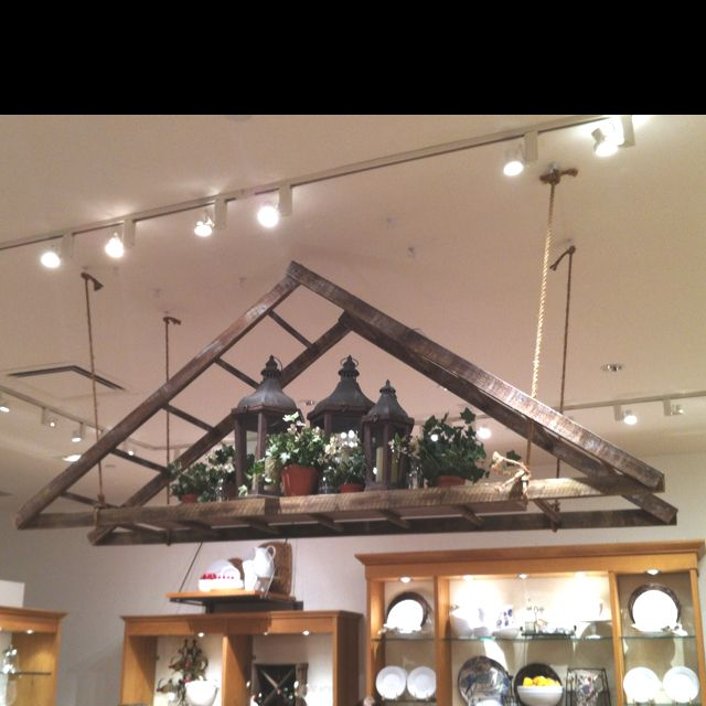 Cool ladder turned into a display at Pottery Barn (not for sale!). Would make a great pot rack too.