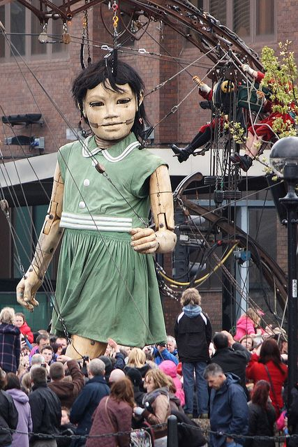 Little Giant Girl walking along Strand Street, Liverpool waterfront, Merseyside, UK (by Ministry)
