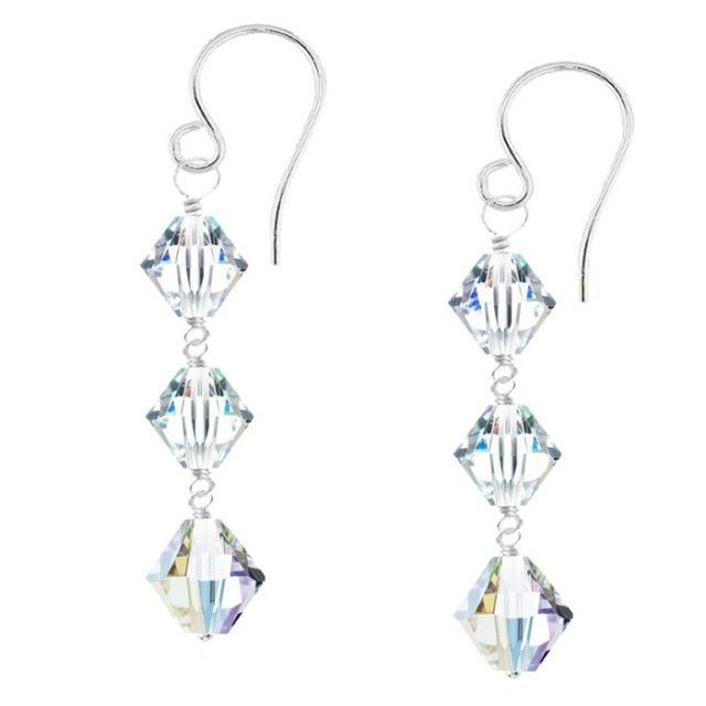 Aphrodite Crystal Earrings - It's love at first signt with these graceful drop earrings. Three sparkling Swarovski crystals are hand wrapped with silver wire and set on sterling silver hooks.  Each glittering crystal measures 6mm in length and the final crystal is 10mm in length. Aphrodite literally dances with light with every movement of your head.
