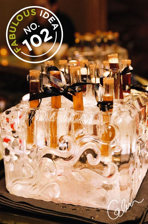Sculpted Spirits: What better way to offer guests test tube indulgences than in a custom ice sculpture?