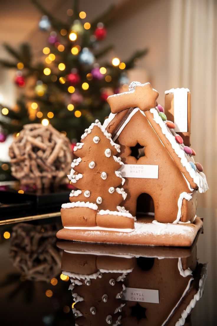 An elegant rendition of a gingerbread house is beautifully decorated with silver sugar pearls. #LivingGrand | Grand Hyatt