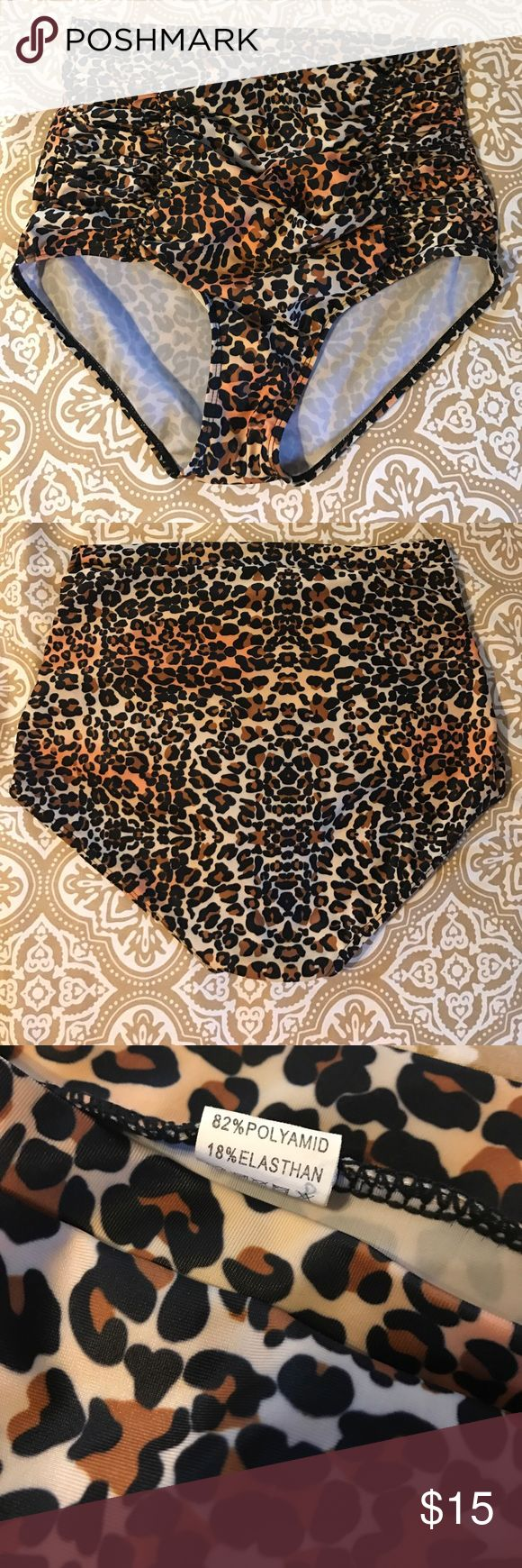 Leopard Animal Print High-Waisted Bikini Bottom Over the belly button, these high waisted bikini bottoms are sassy and sexy and with the scrunchy front, so very flattering! Pair them with a neon or solid top to turn heads & get TONS of compliments. Size is XL, but fit more like an M (8/10) - these are truly stunning & SLIMMING and will make you feel like a million bucks while soakin' up the sun! ☀️ Swim Bikinis
