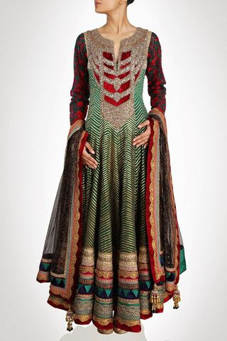This anarkali suit is on chanderi silk in green color embellished with full of gotta work on it. Sleeves of this anarkali suit is in red color having blue color thread work on it. Neck of this suit is