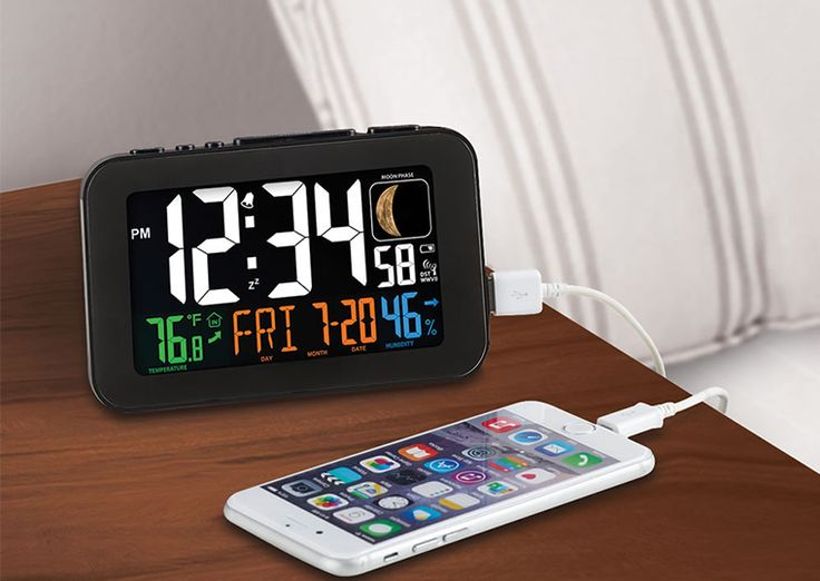 Wake to your current time and weather with the large multi-color atomic alarm clock with USB charging port and temperature display. Self-Setting time and date will also automatically reset during DST changes. Displays moon phase and indoor temp & humidity with your calendar date. Bright... - Madeofmillions.com