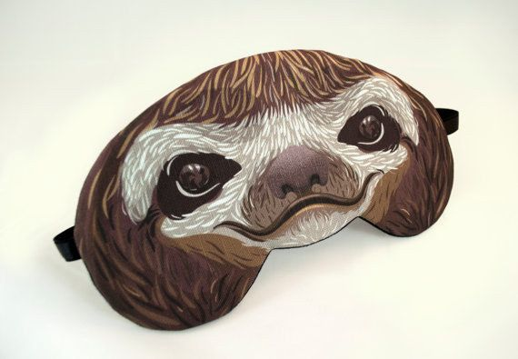This sleeping mask. Because what better way to take a snooze than with snoozing's mascot over your eyes? | 27 Adorable Things Every Sloth Lover Needs
