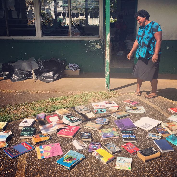 This is Vatiseva, a school librarian from Port Vila, Vanuatu. She is trying to dry out the library books that survived Cyclone Pam ahead of school classes resuming. Her school lost more than 200 books in the destruction.