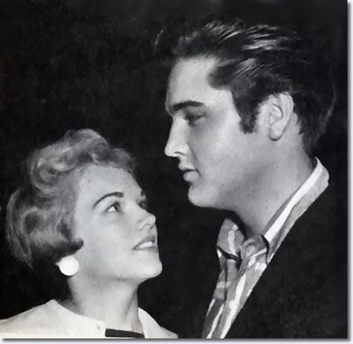 What can idolize the Anita – Elvis Presley and his girlfriend at the airport in Memphis, 13. Description from memphisflash.de. I searched for this on bing.com/images