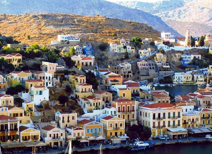 Symi island is so perfect you'll feel as if you've stepped into the midst of a film set.  We invite you to soak it up.  #Celestyalcruises #Symi #island #Greece #vacation #travel #cruise #Aegean #holiday  Photo Credits: Phoebe Grayling