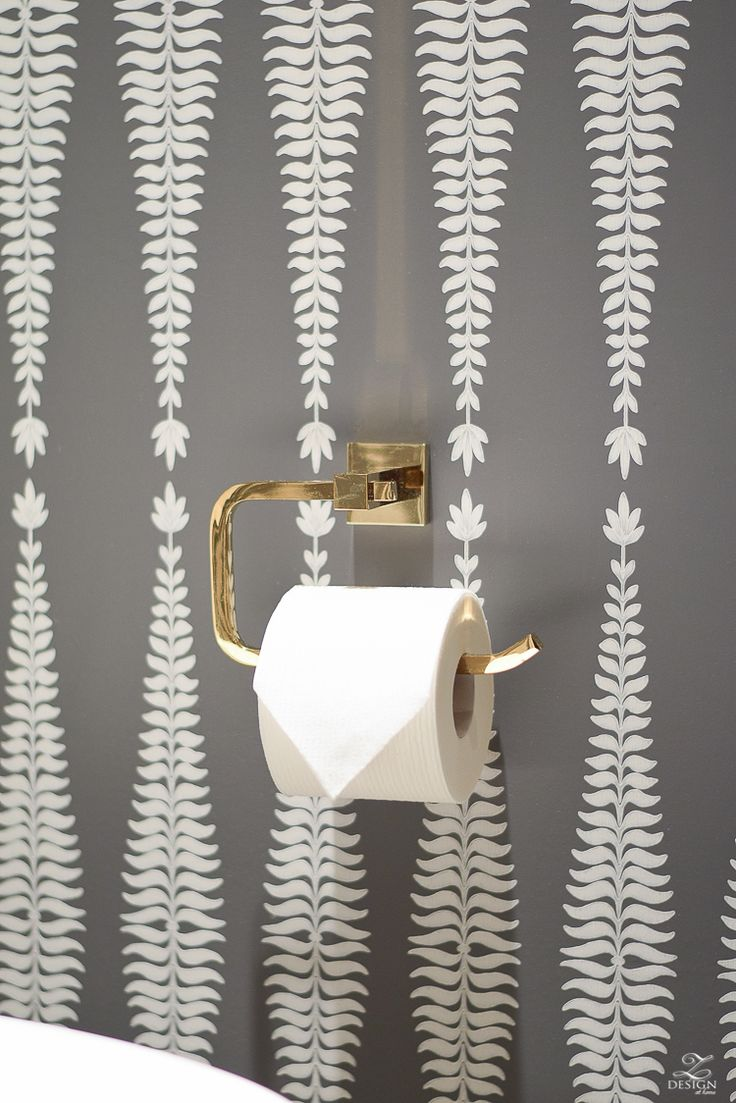 brass toilet paper holder bath fixtures Beautifully decorated powder room with schumacher fern tree wallpaper in graphite -1