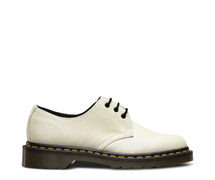 The second style that Dr. Martens made, the 1461 was crafted for industry, made rebellious by generations of non-conformists — and now it's coated in a frosty winter-white glitter. The 1461 is crafted with the same DNA as its 8-eye counterpart: grooved edges and unmistakeable yellow stitching. Made with leather coated in Aurora, a glitter material with lilac, silver and iridescent glitter particles Classic 3-eye lace fastening, with glossy black eyelets Built on our iconic, comfortable ai...