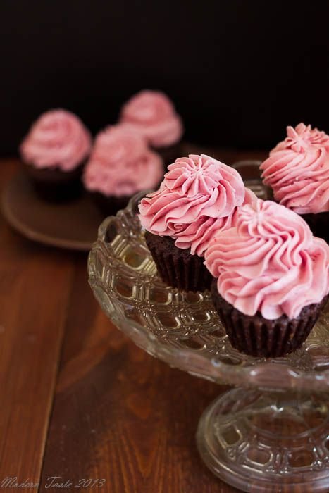 Chocolate cupcakes with raspberry swiss meringue buttercream frosting