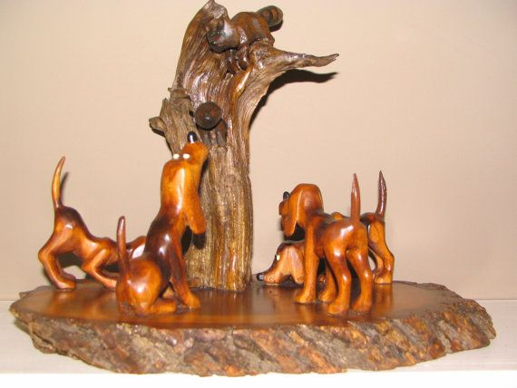 Reduced price vintage woodcarving coon hound dogs