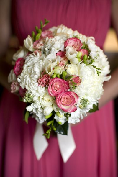 electra spray roses, white football mums, white stock, white phlox, white roses, and white freesia - sure would like this for my table on Mother's day! (hint hint boys!!) :)