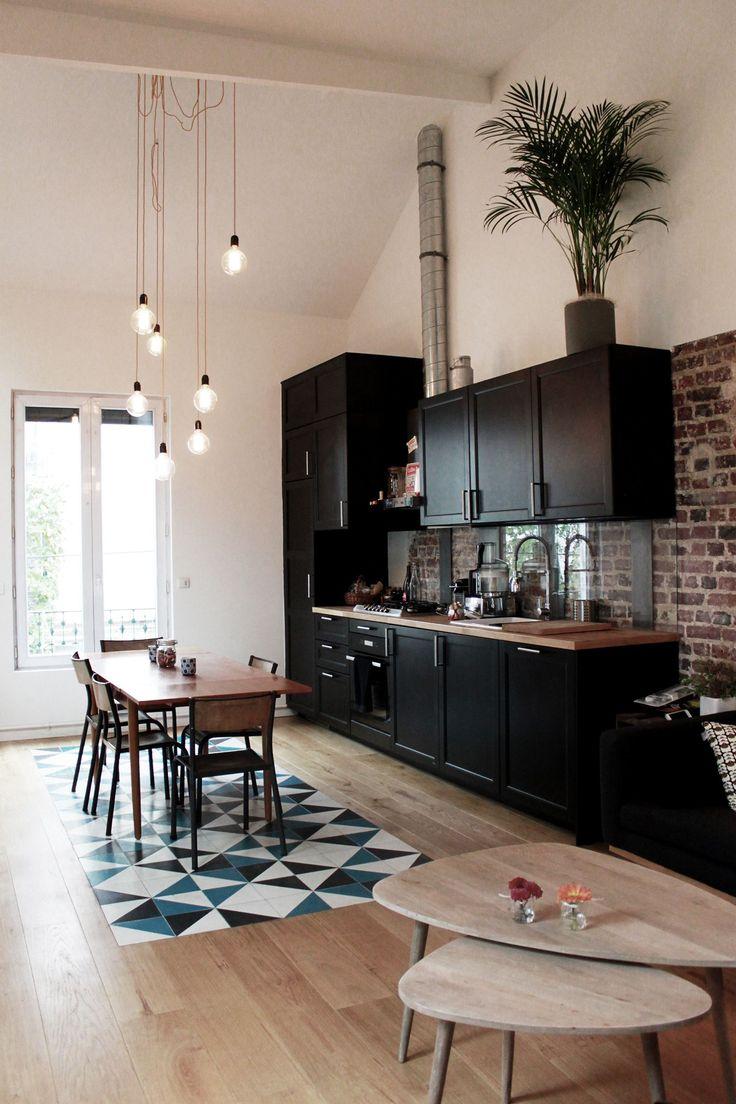 Black matte cabinets, wood and brick, hanging lights