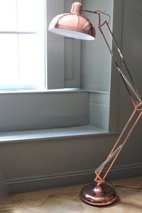 Copper Angled Floor Lamp - big one on floor at end of the sofa in the book room