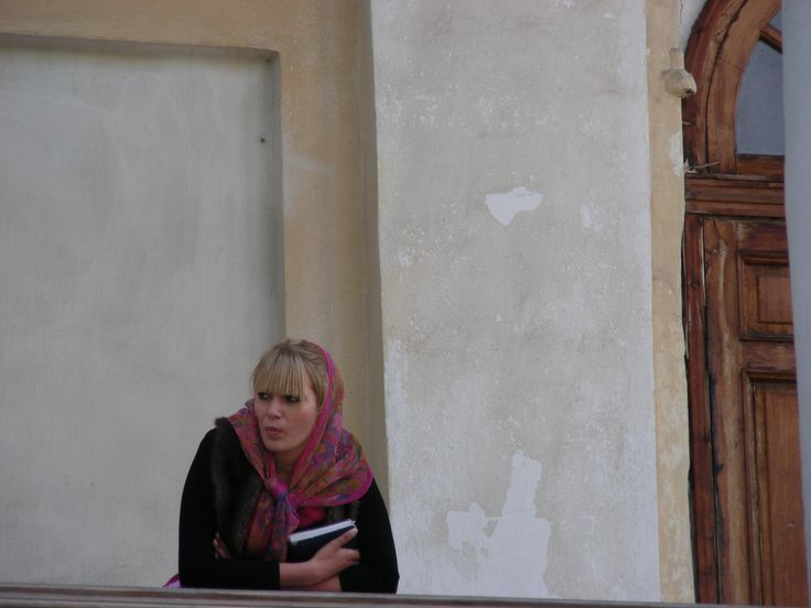 A local woman people watches in the city of Yaroslavl, Russia.