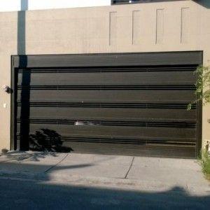 Puerta de garage de herrer a con barras gruesas - Garajes de metal ...